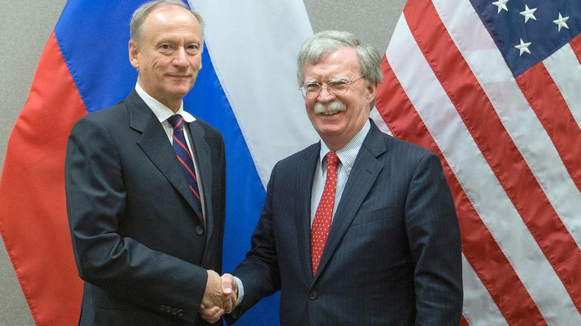 US National Security Advisor John Bolton (R) with his Russian counterpart Nikolai Patrushev during a meeting at the US Mission in Geneva. (AFP)