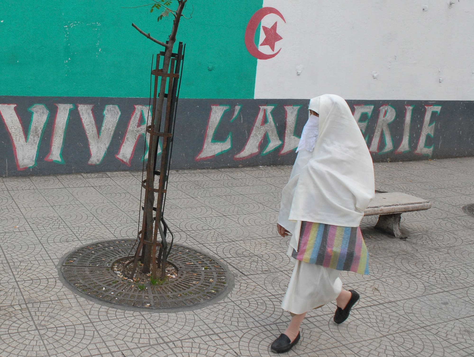Al-Hayek is an off-white full body dress, usually made of wool or silk, and sometimes a piece of fabric is added to cover the face without the eyes. (AFP)