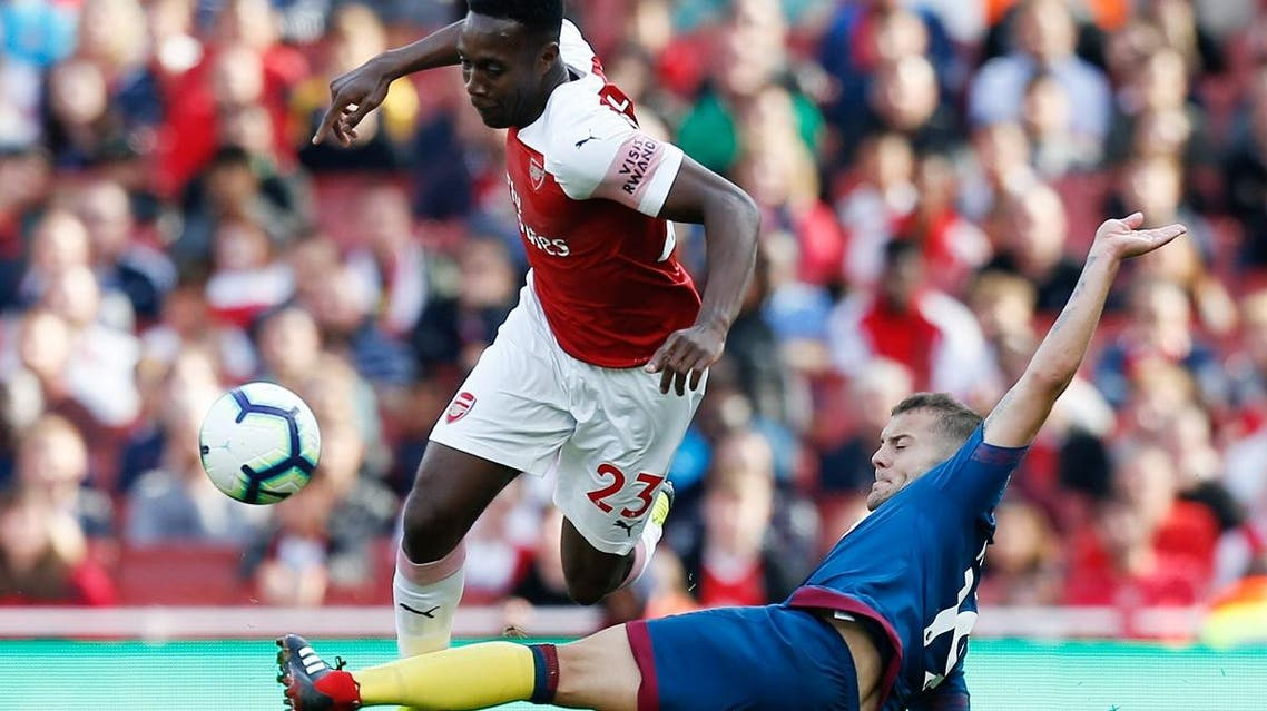Arsenal's English striker Danny Welbeck (L) is challenged by West Ham United's English midfielder Jack Wilshere (R) during the English Premier League football match at the Emirates Stadium in London on August 25, 2018. (AFP)