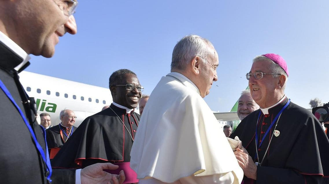 Pope Francis (C) being greeted by Archbishop of Dublin Diarmuid Martin on arrival at Dublin airport on August 25, 2018 to attend the 2018 World Meeting of Families. (AFP)