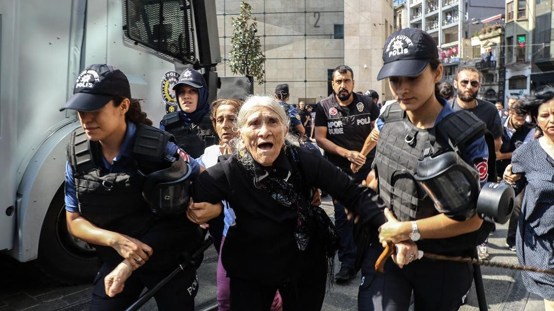 Emine Ocak, a a member of Saturday Mothers Turkish group is detained by Turkish female riot police during a demonstration on August 25, 2018 in Istanbul (AFP)