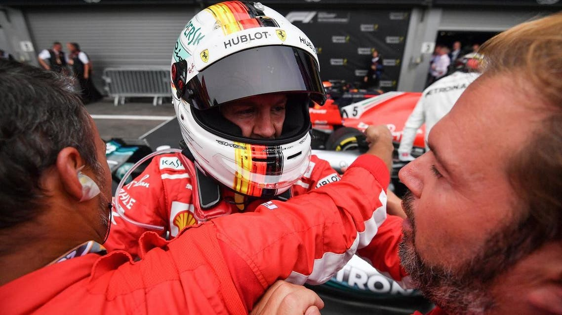 Ferrari's German driver Sebastian Vettel is celebrated by teammates after winning the Belgian Formula One Grand Prix at the Spa-Francorchamps circuit in Spa on August 26, 2018. (AFP)