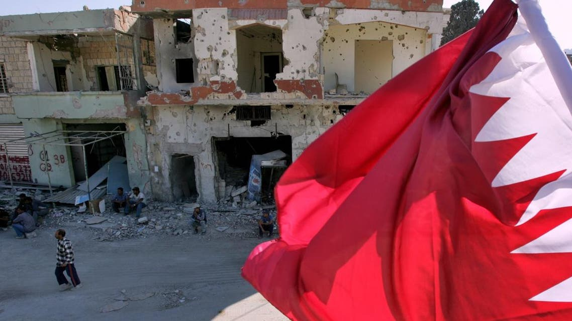 The flag of Qatar flies over the bombed center of the southern city of Bint Jbeil, Lebanon, Saturday Oct. 7, 2006. (AP)