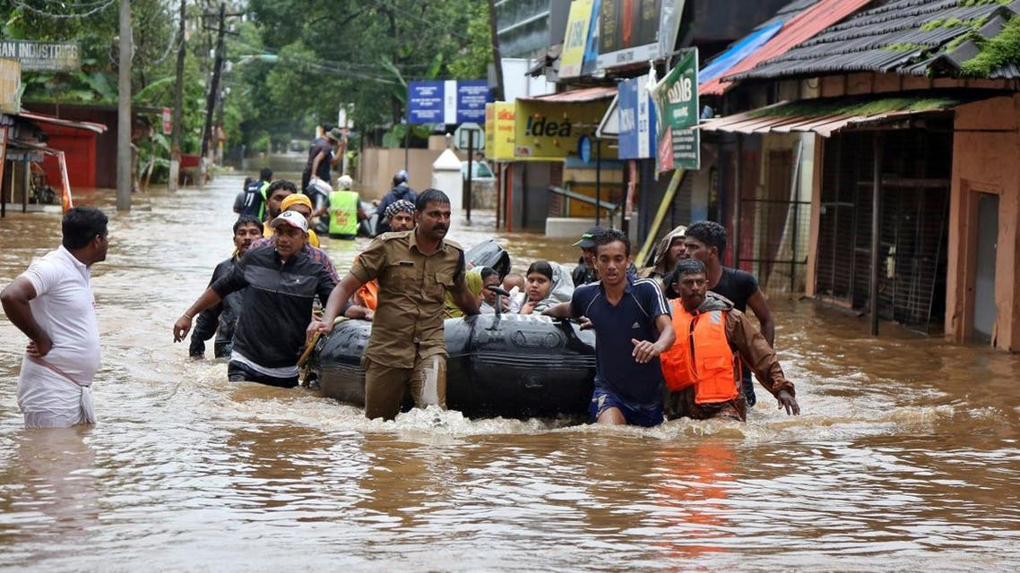 Rescuers evacuate people from a flooded area to a safer place in Aluva. (Reuters)