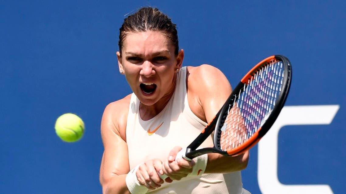 Simona Halep of Romania hits to Kaia Kanepi of Estonia on day one of the 2018 US Open. (Reuters)