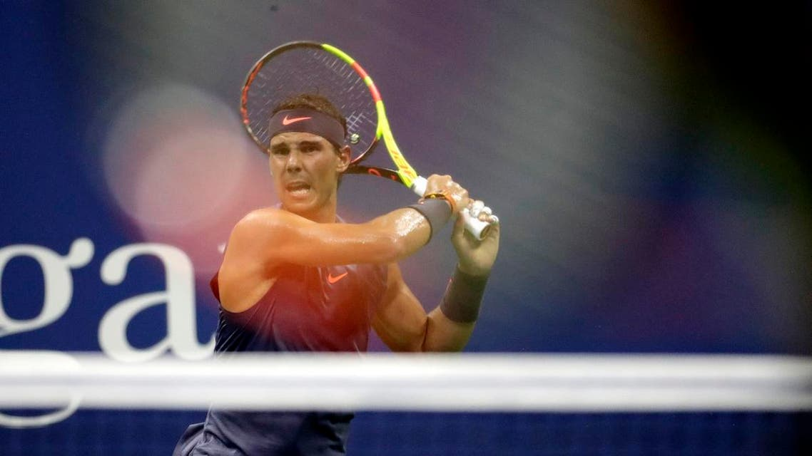 Rafael Nadal, is viewed through the racket of David Ferrer, during the first round of the US Open. (AP)