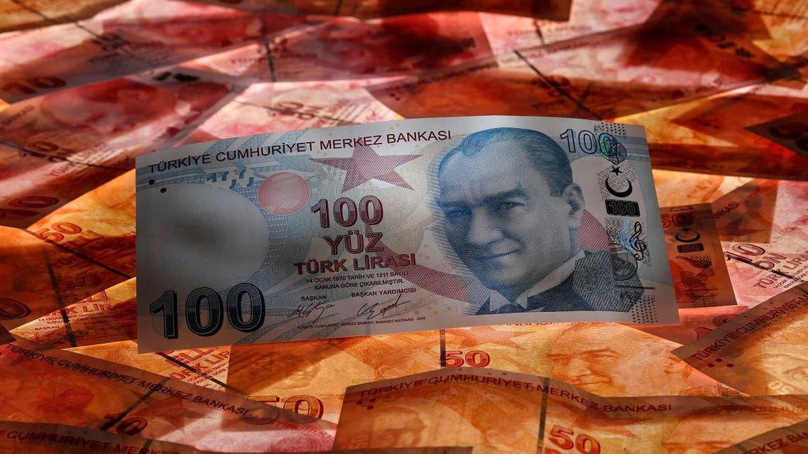 A 100 Turkish lira banknote is seen on top of 50 Turkish lira banknotes in this picture illustration in Istanbul. (Reuters)
