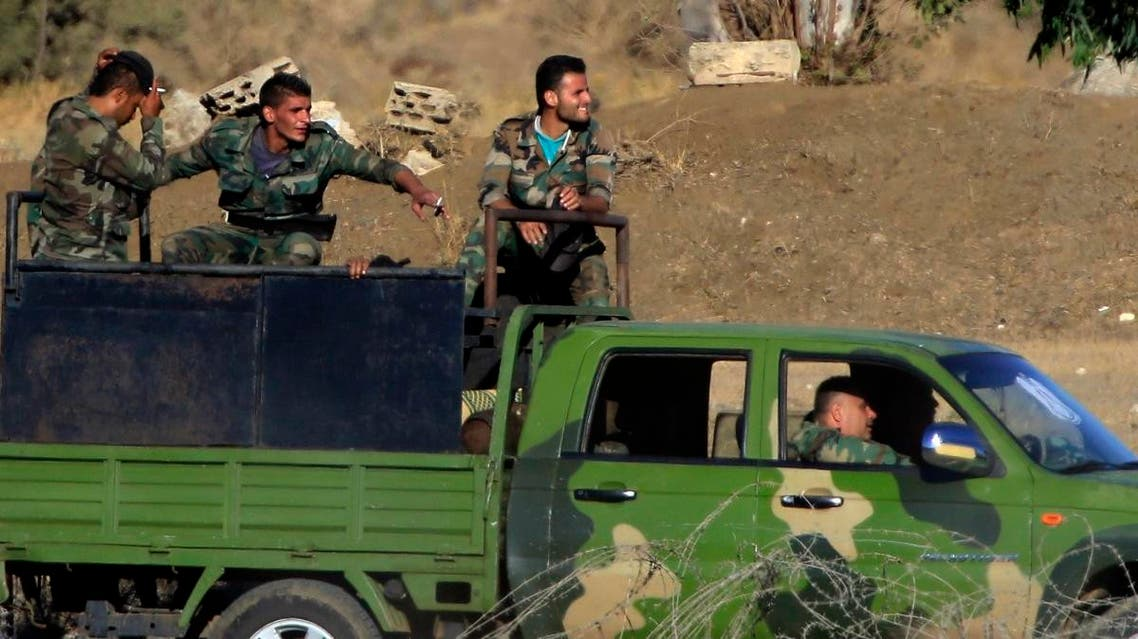 Syrian soldiers arrive to Syria's Quneitra border crossing between Syria and the Israeli-controlled Golan Heights. (AP)