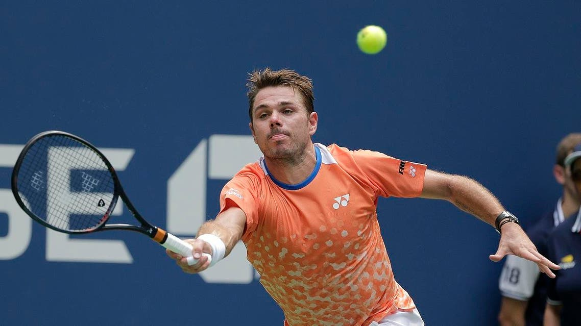 Stan Wawrinka, of Switzerland, returns a shot to Grigor Dimitrov, of Bulgaria, during the first round of the U.S. Open tennis tournament. (AP)