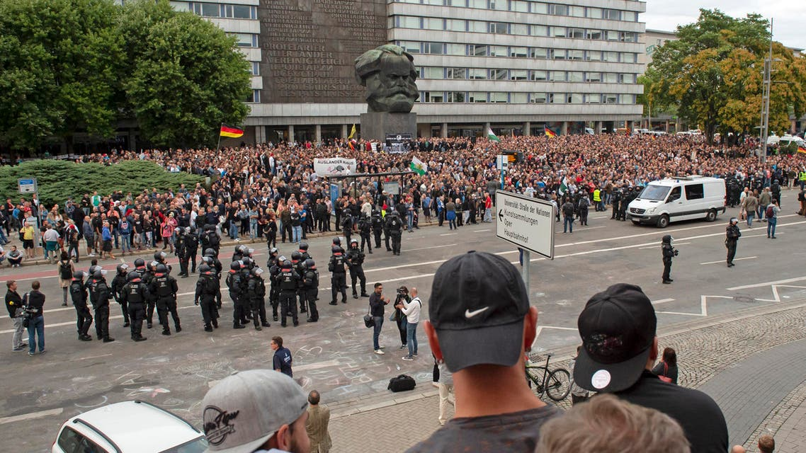 Protesters gather for a far-right protest in front of the Karl Marx Monument in Chemnitz, Germany, Monday, Aug. 27, 2018. (AP)