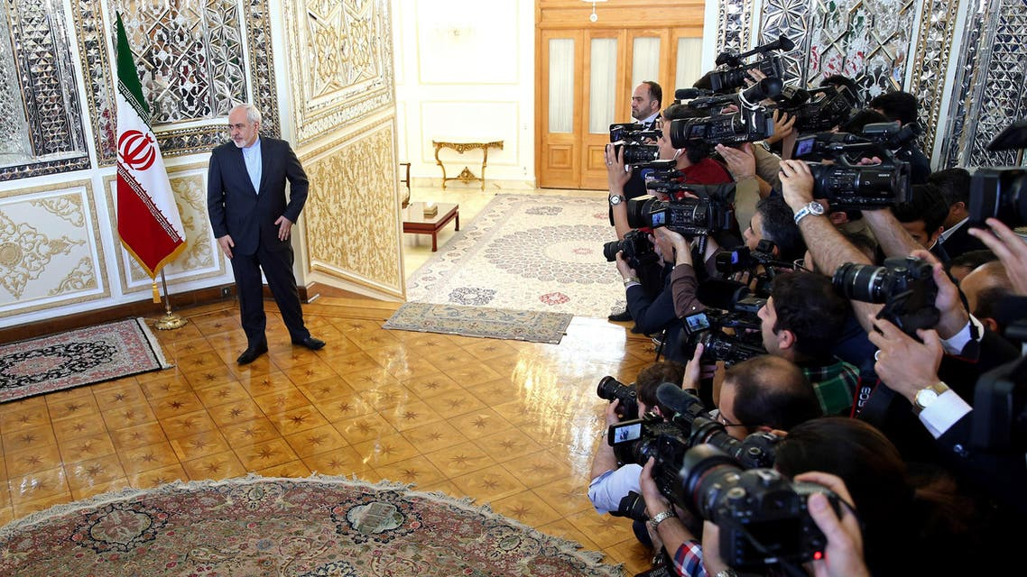 Iranian Foreign Minister Mohammad Javad Zarif waits to welcome European Union foreign policy chief Federica Mogherini in Tehran on April 16, 2016. (AP)