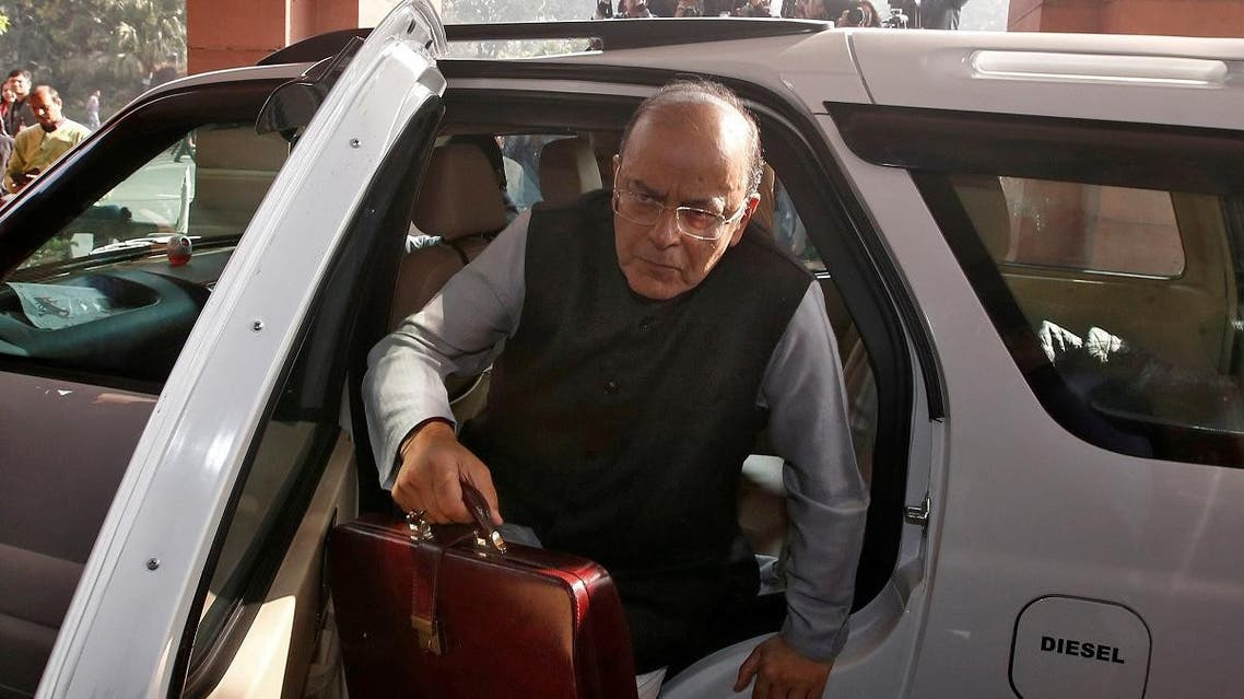 India's Finance Minister Arun Jaitley holds his briefcase as he arrives at the parliament to present the federal budget in New Delhi, India, February 1, 2018. (Reuters)