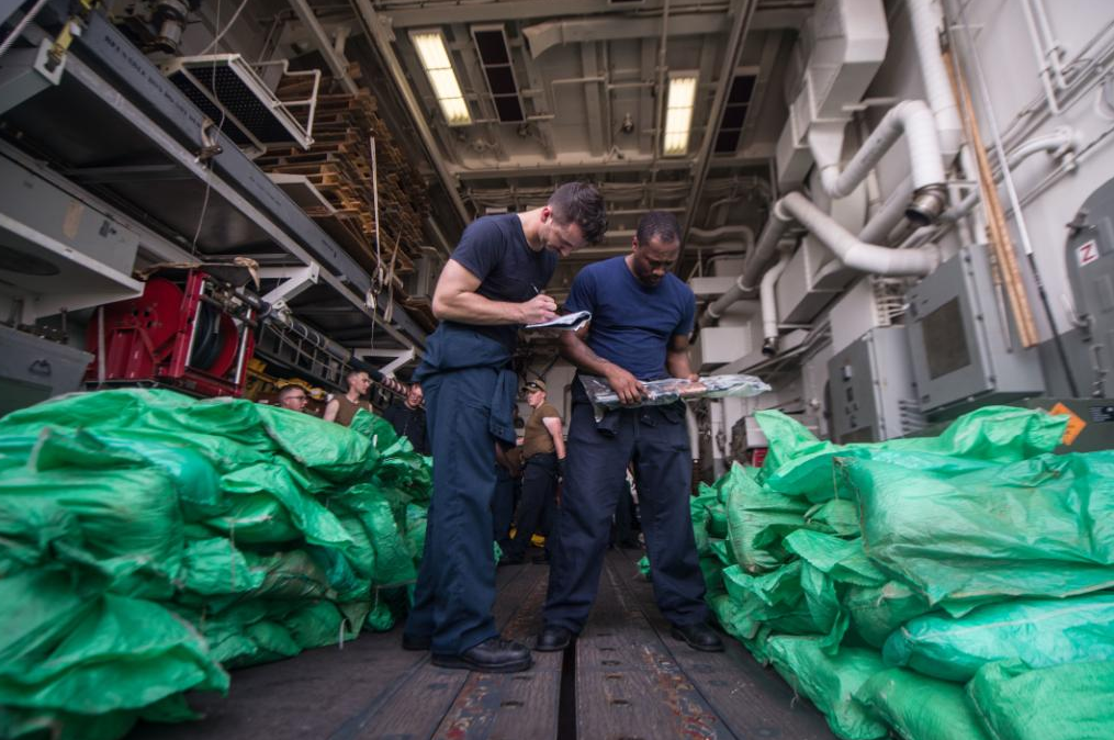 US navy siezes small arms on boat in gulf od Aden. (US Navy)