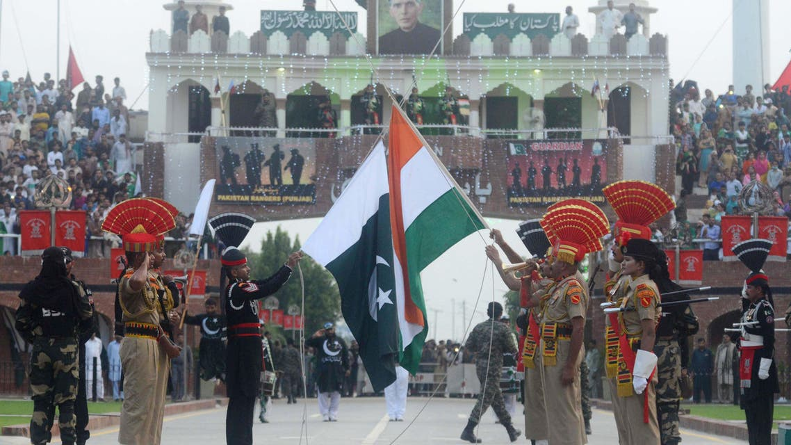 Indian BSF personnel (brown uniforms) and Pakistani Rangers (black uniforms) at the India-Pakistan Wagah Border Post on August 15, 2018. (AFP)