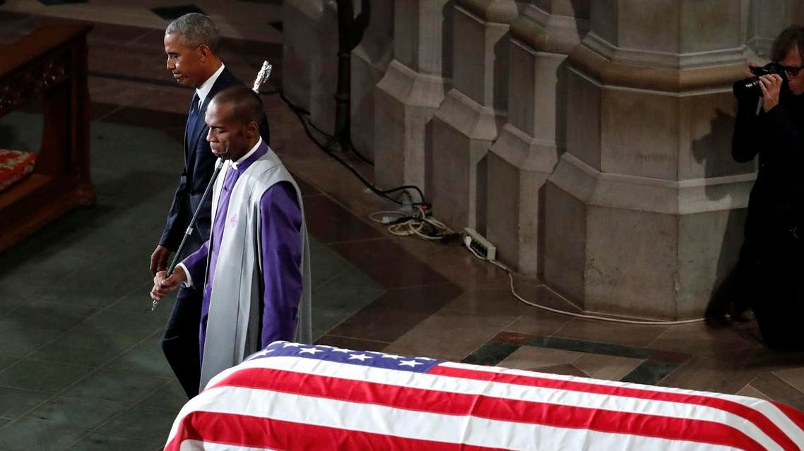 Former President Barack Obama is escorted after speaking at a memorial service for Sen. John McCain. (AP)