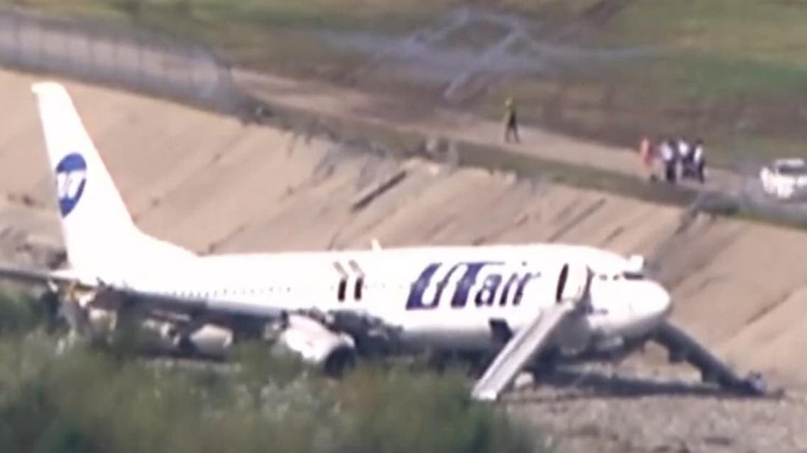 Russian passenger plane Utair's Boeing 737-800, carrying 164 passengers and six crew members from Moscow to Sochi ran off the runway early on Saturday and caught fire injuring 18 people.  (Screengrab from Reuters video)