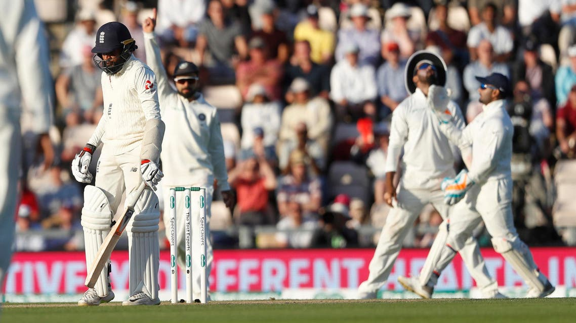 England's Adil Rashid, walks off after being given out caught behind of the bowling of India's Mohammed Shami during play on the third day of the 4th cricket Test match. (AP)