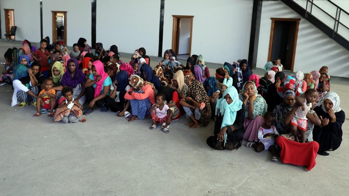Migrants are seen in a shelter after they were relocated from government-run detention centers, after getting trapped by clashes between rival groups in Tripoli. (Reuters)