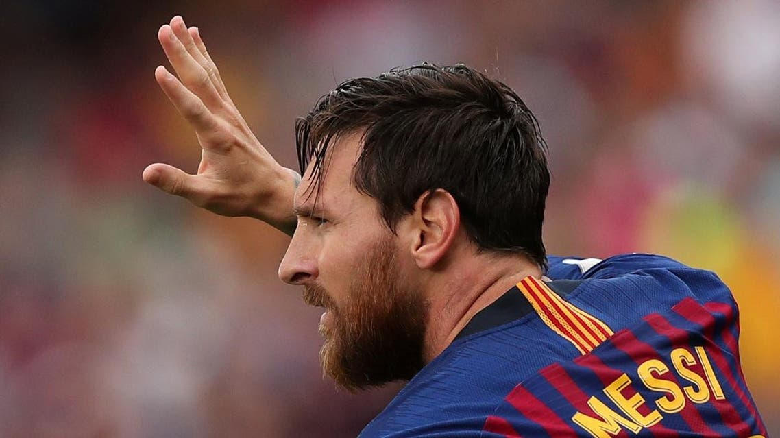 Barcelona's Lionel Messi celebrates scoring their first goal. (Reuters)