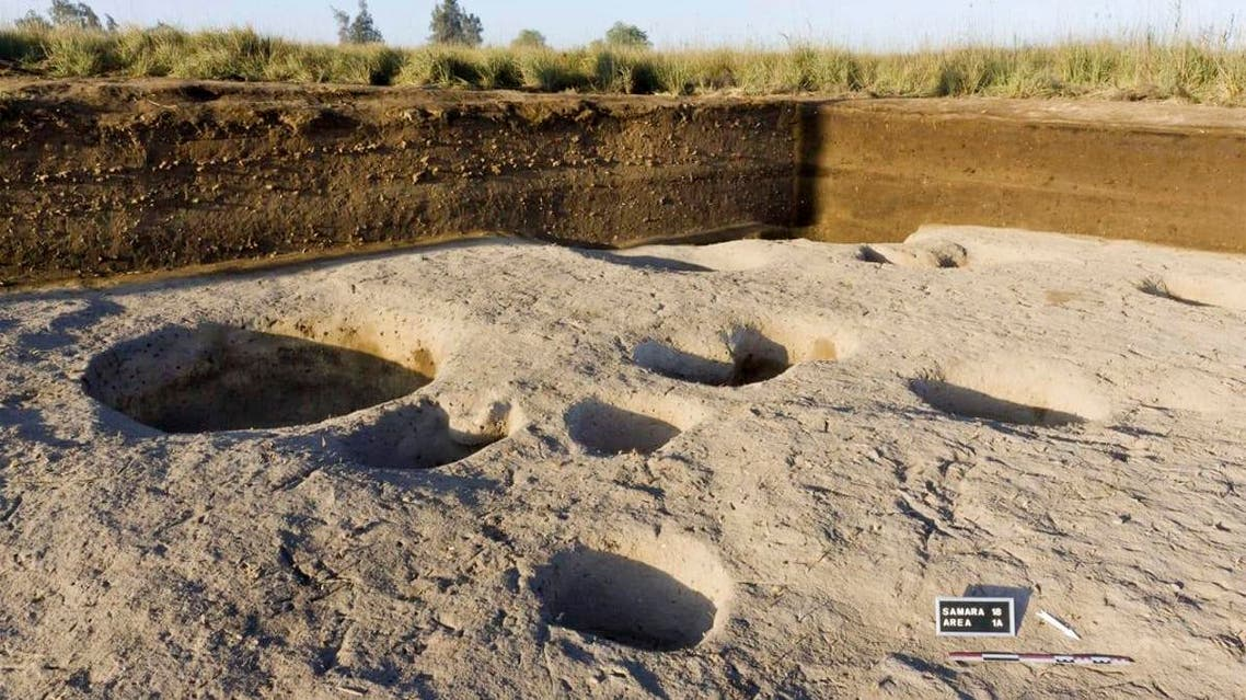 Chief archaeologist Frederic Gio says his team found silos containing animal bones and food, indicating human habitation as early as 5,000 B.C. (AP)