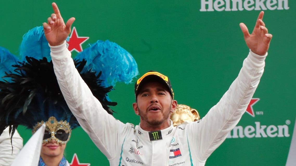 Mercedes' Lewis Hamilton celebrates on the podium after winning the race at Italian Grand Prix, Circuit of Monza, Monza, Italy, on September 2, 2018  (Reuters)