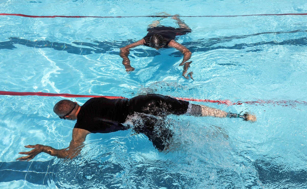Iraqi civilians who lost limbs during the government offensive against ISIS in Mosul swim during a competitive sports event sponsored by the Kuwaiti government in Erbil. (AFP)