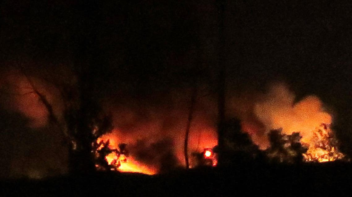 A general view shows flames and smoke at the Mezzah military airport on the southwestern outskirts of the capital Damascus following an explosion early on January 13, 2017. (File photo: AFP)