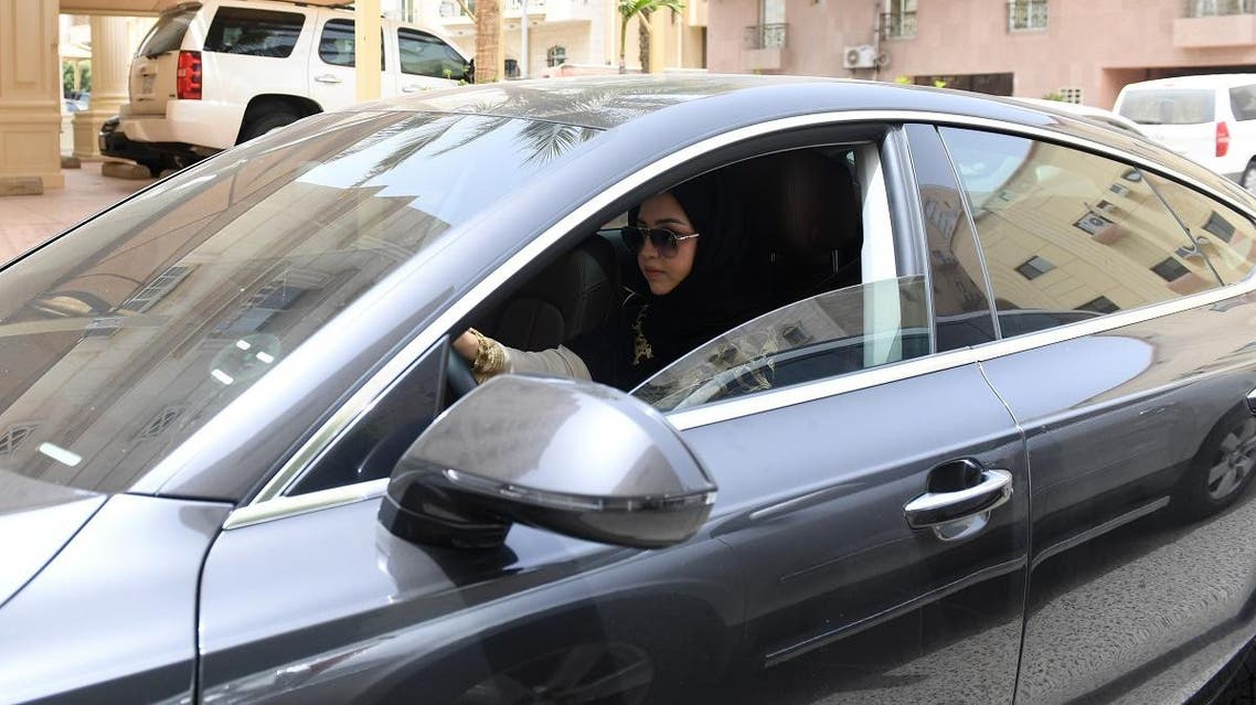 Daniah al-Ghalbi, a newly-licensed Saudi woman driver, sits in her car during a test-drive in the coastal Red Sea city of Jeddah on June 23, 2018. (AFP)