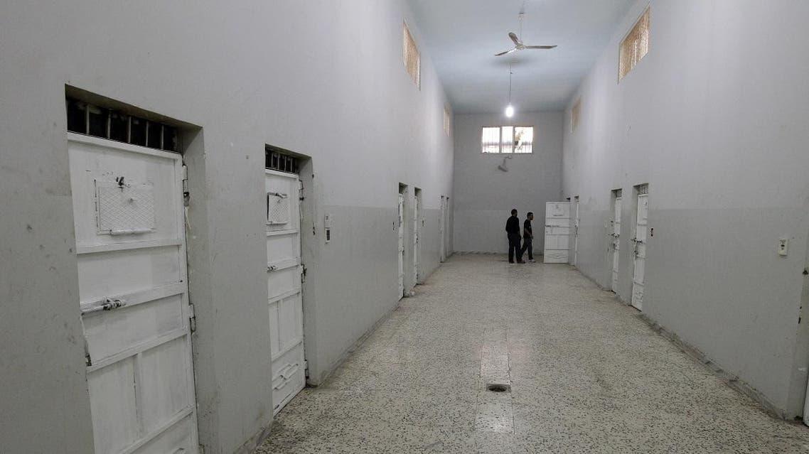 Guards check on a prisoner at the Qaddafi-era political prisoners jail Ain Zara in Tripoli on November 16, 2011. (AFP)