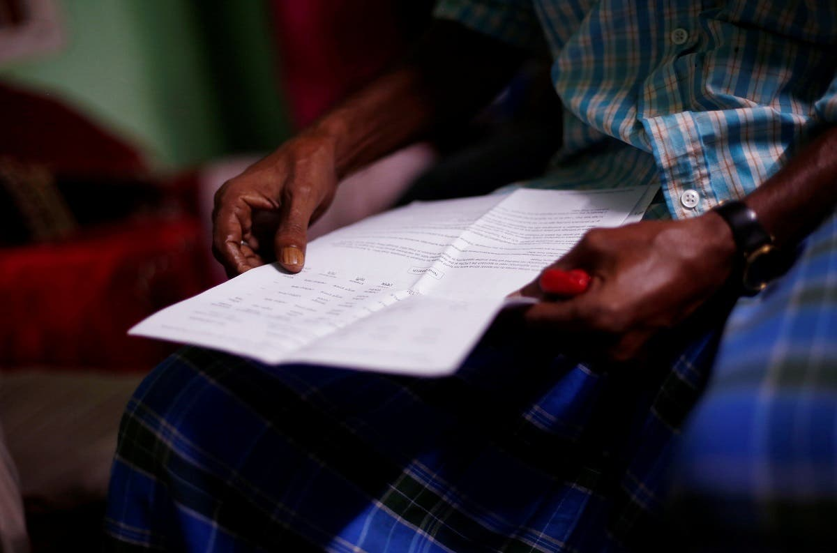 Ayub Salm holds the draft list of the National Register of Citizens (NRC) of his family in Dhubri district. (Reuters)