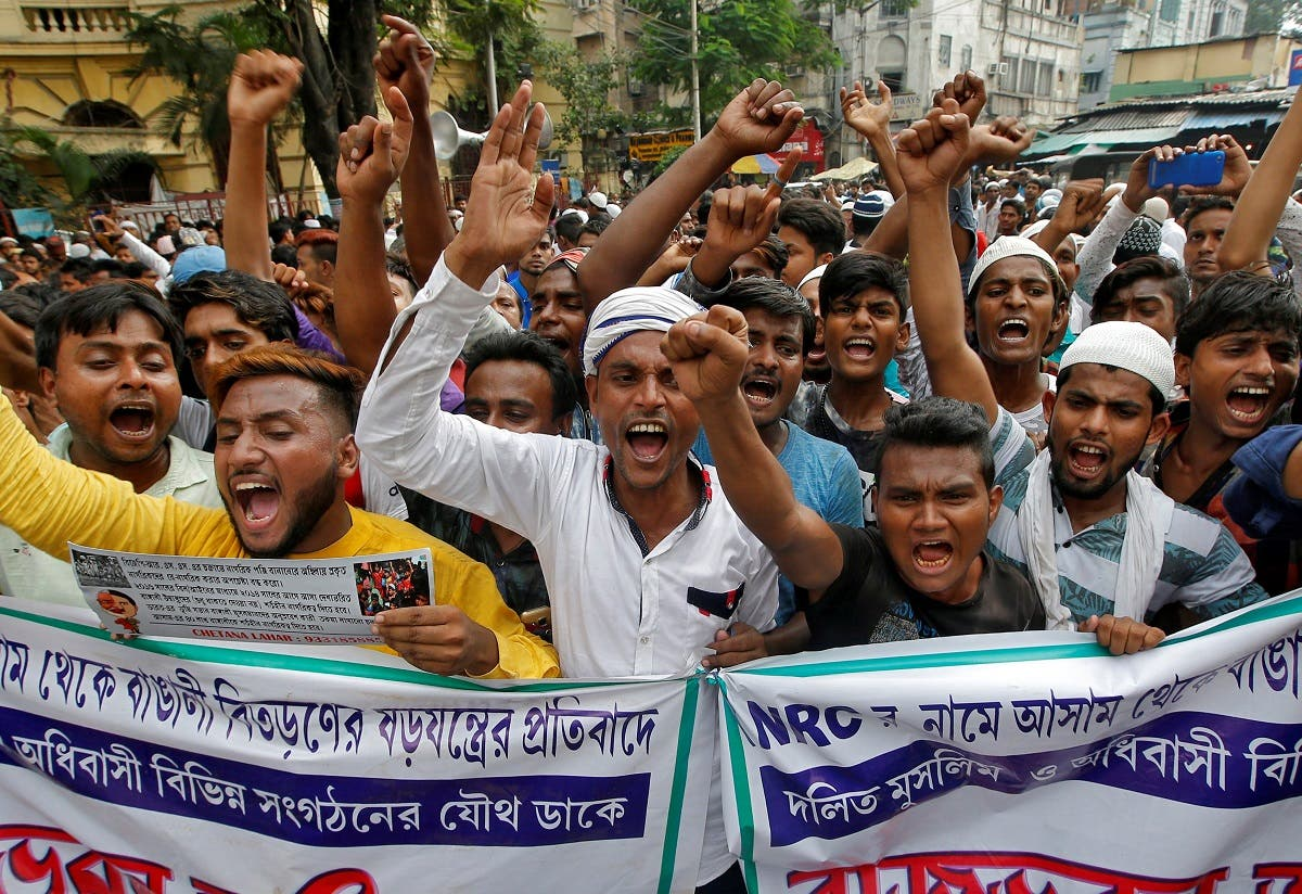 People shout slogans during a protest against what they say is the draft list of the NRC in the northeastern state of Assam, in Kolkata. (Reuters)