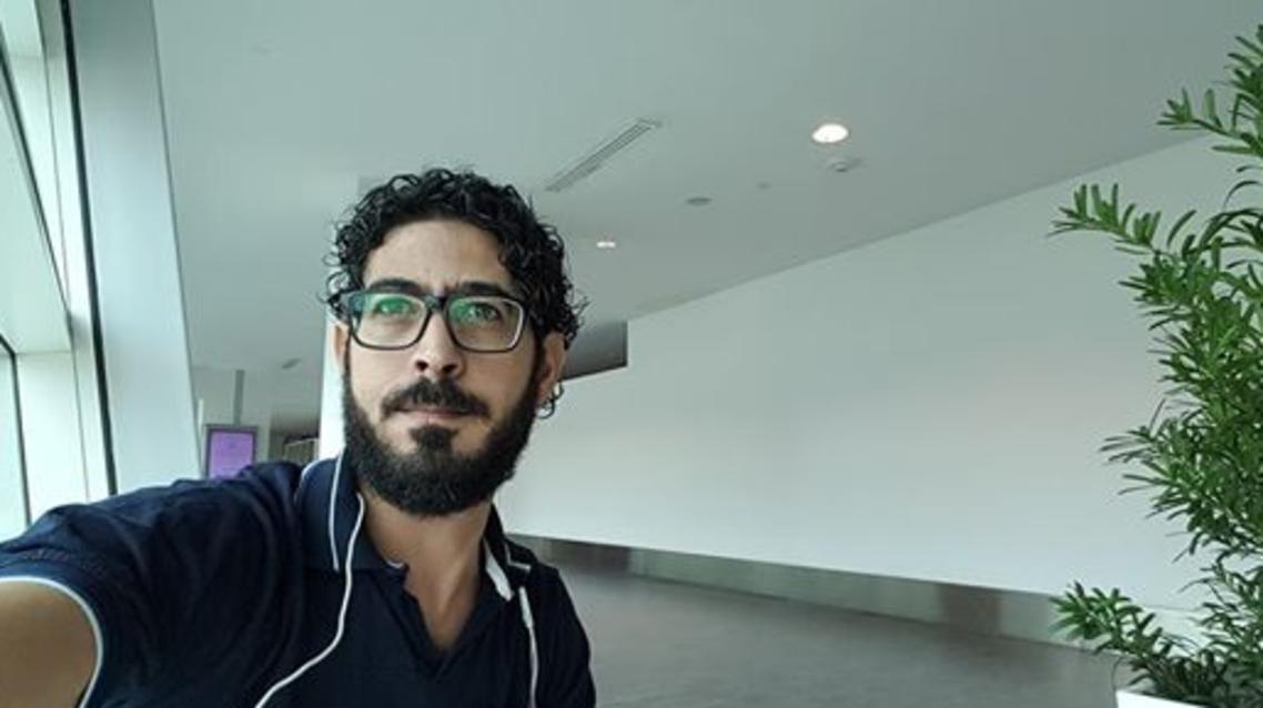 Hassan al-Kontar Syrian refugee in Kuala Lumpur airport. (screen grab)