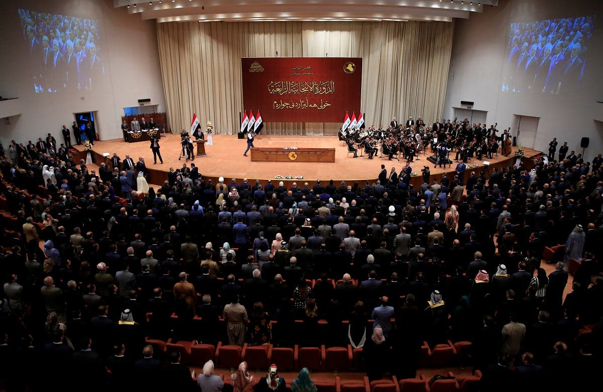 Iraqi lawmakers are seen during the first session of the new Iraqi parliament in Baghdad. (Reuters)