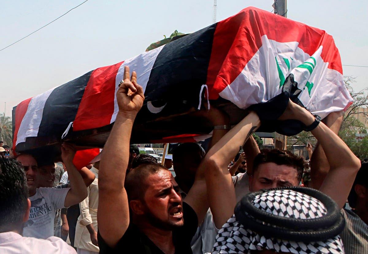 Mourners carry the Iraqi flag-draped coffin of Mekki Yasser, Basra, Iraq. (AP)
