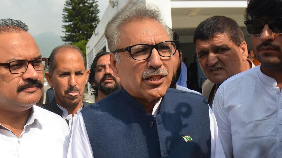 Leader of ruling Pakistan Tehreek-e-Insaf (PTI) party and president candidate Arif Alvi (C) arrives before the president election at the National Assembly in Islamabad. (AFP)