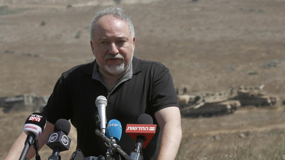 Avigdor Lieberman addresses the media during a visit to the Israel-Syria border in the annexed-Golan Heights on August 7, 2018. (AFP)