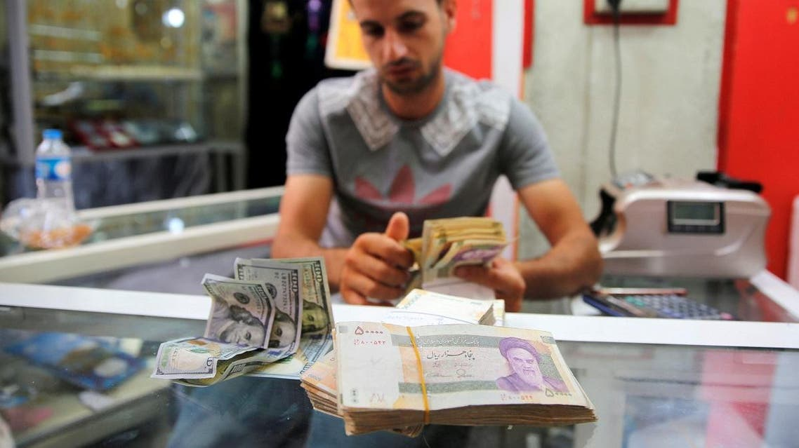 Iranian rials are seen at a currency exchange shop in Baghdad. (Reuters)