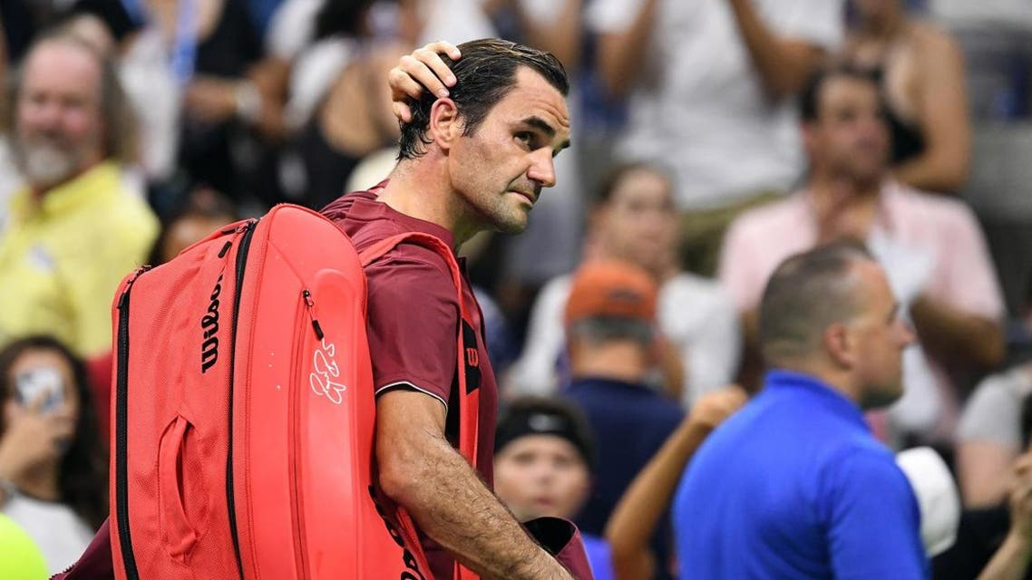 Roger Federer of Switzerland walks off the court after his loss to John Millman. (Reuters)