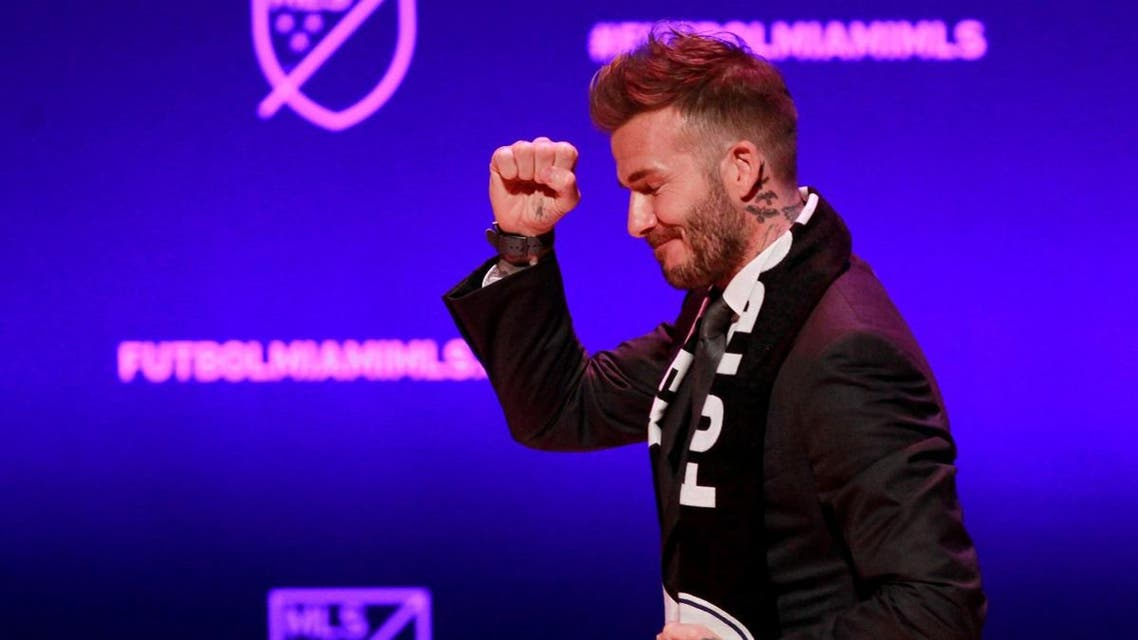 David Beckham, wearing a league scarf, salutes a section of the crowd at this official announcement for Miami's MLS expansion team in Miami, Florida. (Reuters)