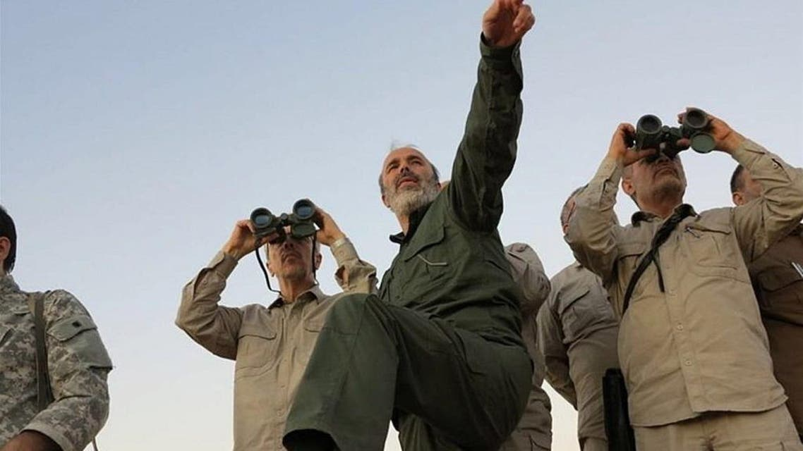 Iran's army chief of staff Maj. Gen. Mohammad Bagheri, left, looks into binoculars as he visits and other senior officers from the Iranian military a front line in the northern province of Aleppo, Syria. (File photo: AP)