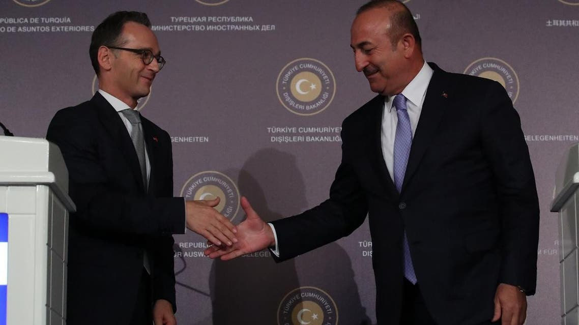 Turkish Foreign Minister Mevlut Cavusoglu shakes hands with his German counterpart Heiko Maas during a news conference in Ankara on September 5, 2018. (Reuters)