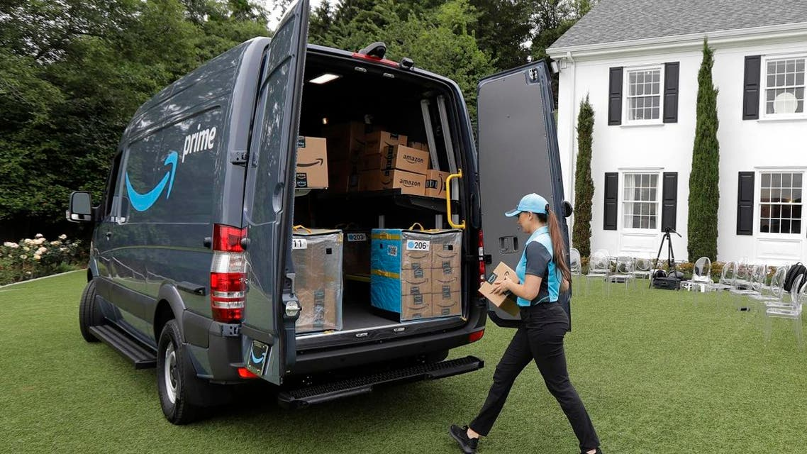 Parisa Sadrzadeh, a senior manager of logistics for Amazon.com, demonstrates a package delivery for journalists at a media event in Seattle. (AP)
