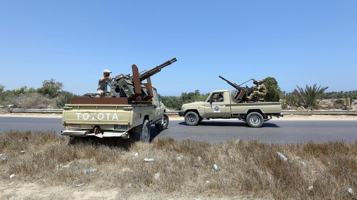 Libyan security forces stand guard at a checkpoint on August 23, 2018 at the site of an attack in Zliten, 170 km east of the capital Tripoli. (AFP)