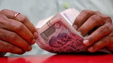 Under-pressure Indian rupee hits record low against dollar
