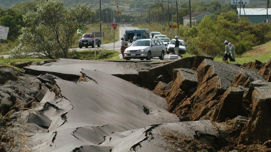 File photo of workers preparing to repair a road in Toyokoro which caved in after a powerful quake hit Japan's northern island of Hokkaido. (AP)