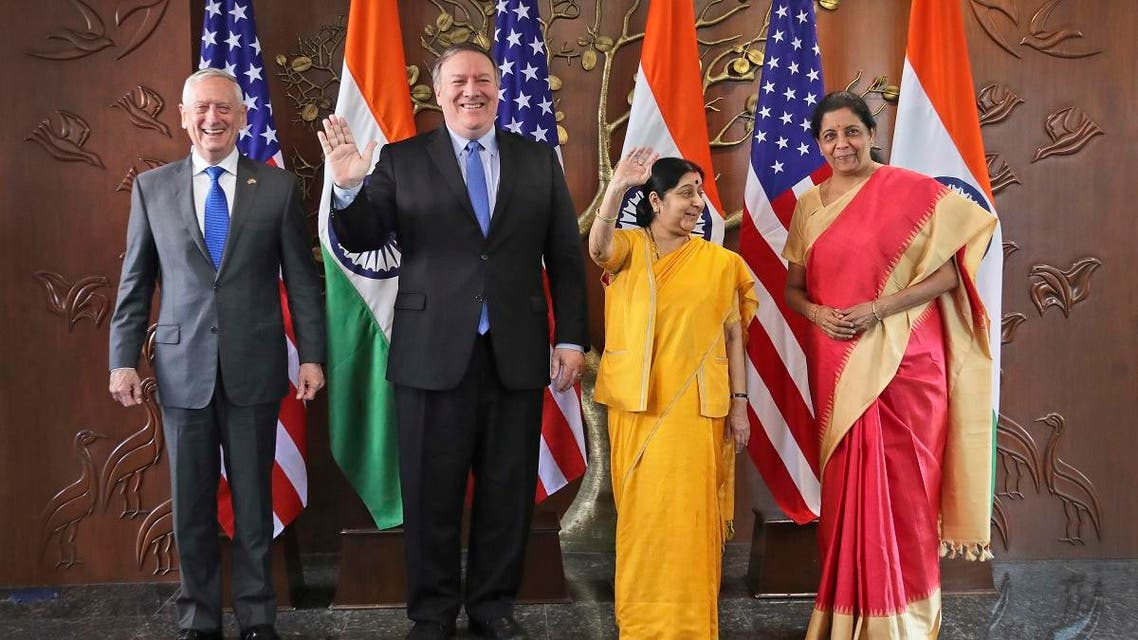 From left, U.S. Defense Secretary James Mattis, U.S. Secretary of State Mike Pompeo, Indian Foreign Minister Sushma Swaraj and Indian Defense Minister Nirmala Sitharaman raise their hands before a meeting in New Delhi, India, Thursday, Sept. 6, 2018. (AP)