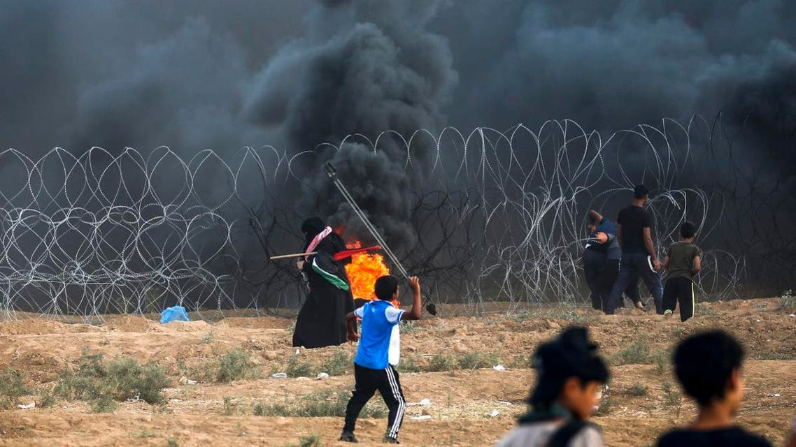 A young Palestinian protester uses a slingshot to hurl stones at Israeli forces during clashes following a demonstration at the Israel-Gaza border, east of Gaza City in the central Gaza Strip on September 7, 2018. (AFP)