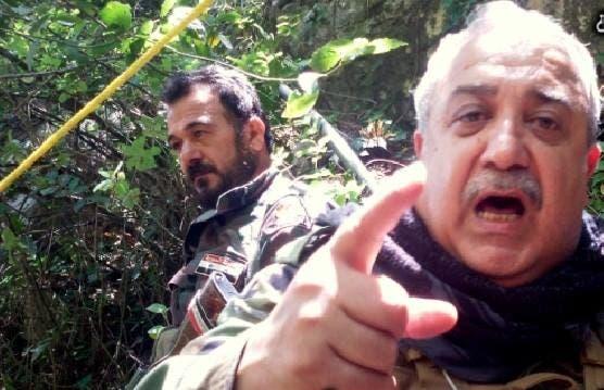 متوعداً المعارضين السوريين في إحدى المناطق