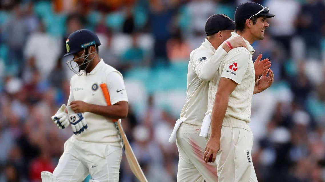 England's Alastair Cook celebrates taking a catch to dismiss India's Rishabh Pant at Oval in London on September 8, 2018. (Reuters)