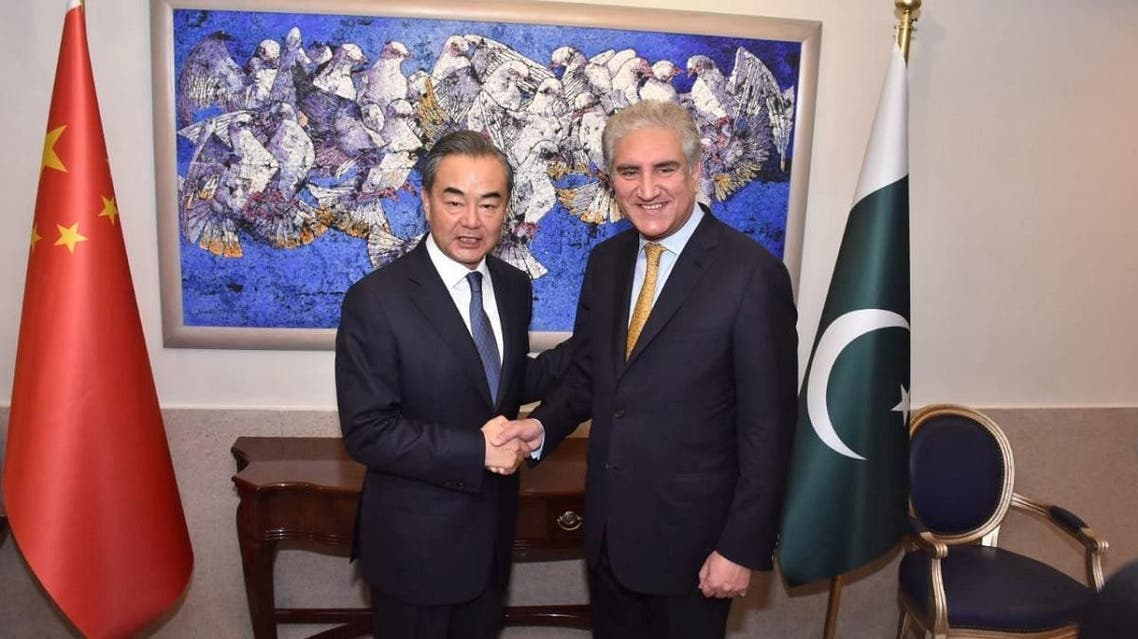 Pakistan's Foreign Minister Shah Mehmood Qureshi shakes hand with State Councillor and Foreign Minister Wang Yi at the Ministry of Foreign Affairs in Islamabad, in Pakistan, on September 8, 2018. (AFP)